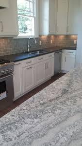 kitchen island granite top sun: black leathered granite top on perimeter ice white granite polished on island handpainted glass