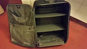 large black samsonite traveller suitcase with optional internal shelves clothes hanger and lock