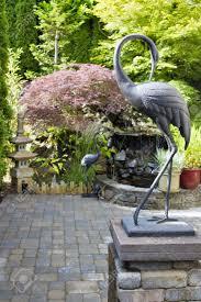 garden cranes. Bronze Cranes Sculpture In Japanese Inspired Zen Garden With Pagoda And Waterfall Stock Photo - 14412720 N