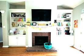 mounting tv above fireplace hiding wires fireplace mantel height
