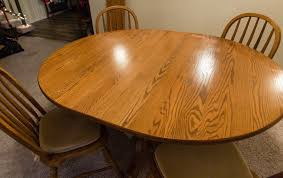 solid oak extending pedestal dining table and 4 chairs 48 x