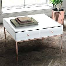 white glass and rose gold coffee table with legs