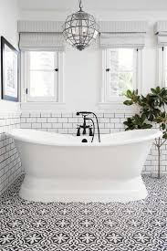 black and white cement tile bathroom floor with free standing tub gorgeous pendant light
