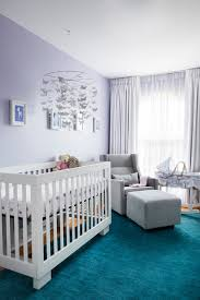 stunning transitional nursery baby s room features erfly mobile with pale lavender walls teal rug with