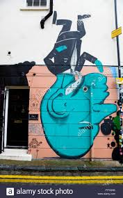 Upside Down Art Street Art Graffiti Of A Blue Man Upside Down On The Wall Of A