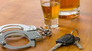 drunk driving consequences criminal penalties costs of driving alcohol car keys handcuffs drunk driving dui