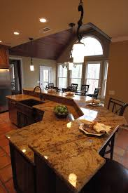 sophisticated white mosaic granite top bar kitchen island with seating and single sink in open plan