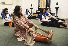the indian minister for women and child development maneka gandhi joining a programme of yoga for pregnant women in 2018