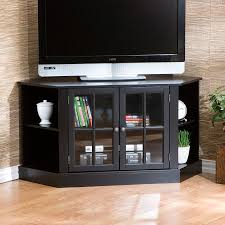awesome black wooden tv stand corner unit with clear glass door and storage shelves design