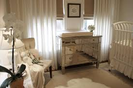 beautiful white gender neutral nursery design with white crib borghese mirrored chest changing table west elm linen cotton grommet window panels white borghese mirrored furniture