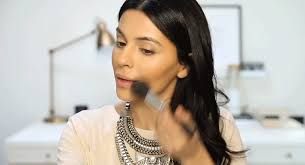 apply matte pink blush to cheeks for a pop of healthy color and finish with highlighter at high points of cheekbones