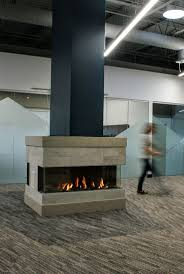 a frameless three sided bay style gas fireplace the trisore 140 by features glass on three sides find a local dealer today