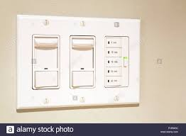 Bathroom Light Dimmer Close Up Of Incandescent Dimmer Lighting Wall Switches And