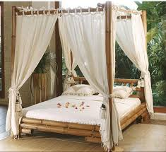 Bamboo Canopy Bed Frame Using White Curtain Placed In Comfortable  Eco-friendly Bedroom Interior Design