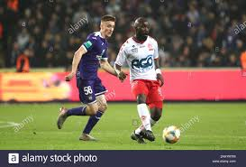 BRUSSELS, BELGIUM - NOVEMBER 24: Herve Kage of Kv Kortrijk battles for the  ball with Alexis Saelemaekers of Anderlecht during the Jupiler Pro League  match day 16 between RSC Anderlecht and KV