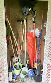 messy shed in need of some garden tool storage