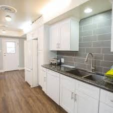 white galley kitchens. White And Gray Kitchen With Quartz Countertops White Galley Kitchens
