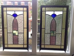 two gorgeous old jugendstil stained glass panels with curved soft colourosaic in oak frames
