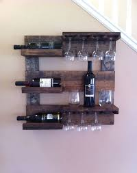 this beautiful wine rack is made from reclaimed pine that i have stained and distressed it measures 24 x 24 with 3 shelves and wine glass holder