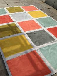 this weekend s diy a rug made from a 6x9 canvas drop cloth painters tape