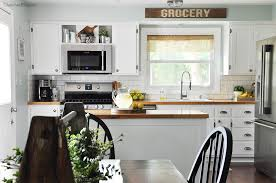 this industrial farmhouse kitchen is both functional and inviting stainless steel appliances bring a professional