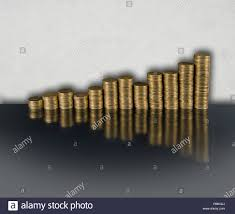 Gold Chart In Euro Gold Coloured Fifty Euro Cent Coins Stacked In The Form Of A