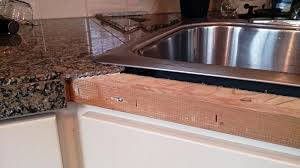 how to install tile countertop edge