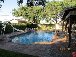 Swimming Pool After Remodel with Rico Rock & Stamped Decking