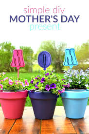 painted plant pots spray painted flower pots for mothers day painting plastic flower pots ideas painting