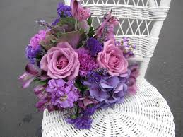 purple roses, hydrangea and lavender with stock, carnations, kale and  statice