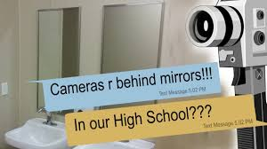 creepy texts about cameras secretly placed behind mirrors in the