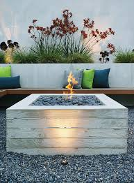 board formed concrete and lava pebbles make this outdoor fire pit table super attractive below are two great diy tutorials to make your own