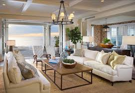 coastal living room design. Medieval Styled Chandelier And White Couch For Coastal Living Room Decor With Sisal Rug Design