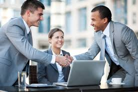Young Business People Making A Business Deal Revenue Group