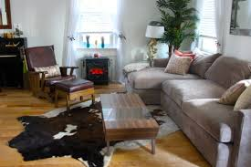 decorating room using faux cowhide rug on home floor design ideas family room decor ideas