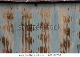galvanized metal siding rusted corrugated metal siding and roof on a building the galvanized metal has