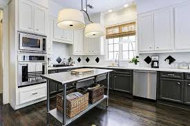 large black kitchen island with black countertops transitional with steel kitchen island