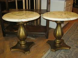 pair of side tables gilded wood base with round marble top 18 diameter 19 high if gold isn t your thing paint the base black taupe cream or a