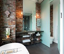 bathroom exposed ceiling lighting bath. interesting ceiling lighting in the bathroom accentuates beauty of exposed brick walls  design crescent builds and bathroom exposed ceiling bath
