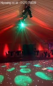 starlit dance floor hire in marquee with event lighting from hipswing