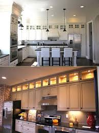 add extra cabinets with gl doors and lighting above kitchen cabinets