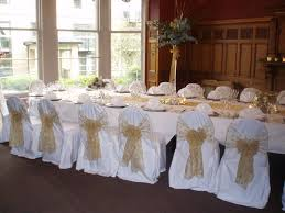 ivory chair covers with gold organza sashes traditional bow at gold embroidered organza sashes on white chair covers at the crown hotel harrogate