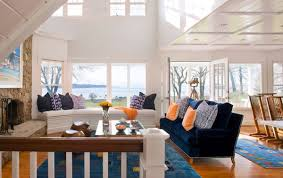 View In Gallery Coastal Living Room With Bright Pops Of Orange