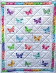 Michele showing us the Dr Seuss book baby quilt she has pieced ... & butterfly quilt for inspiration … Adamdwight.com