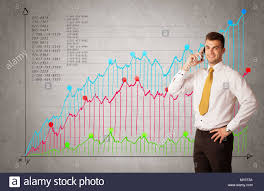 Aa Stock Chart A Confident Young Businessman Standing In Front Of A A Chart