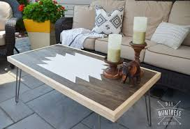 A modern DIY coffee table placed outside