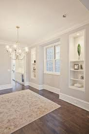 Love the floors and wall color... beautiful room :)  Light Grey ...