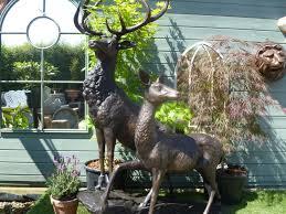 bronze garden statue stag doe standing on rock