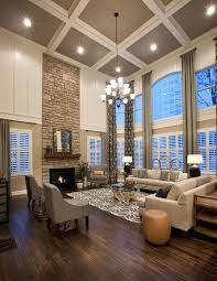 large chandeliers for high ceilings large living room with ceiling stone fireplace dark wood floors floor large chandeliers for high ceilings