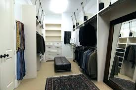 back wall mounted pull down closet rod system systems post hung out valet adjule wardrobe